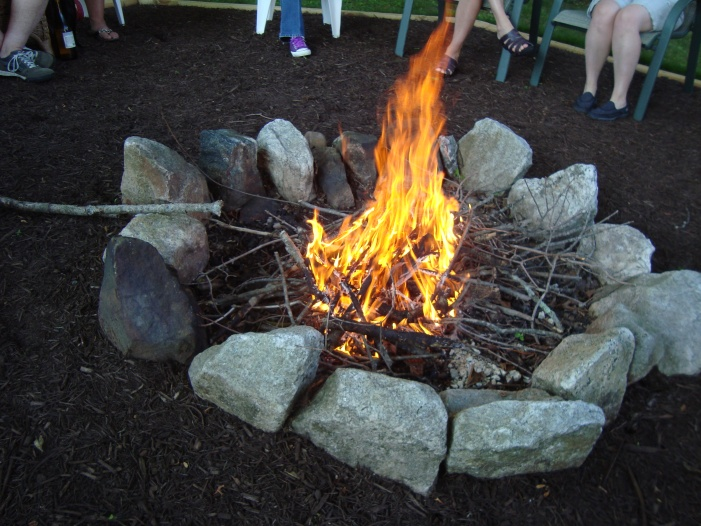 True friends are the ones who will sit around a firepit with you when it is 85 degrees!